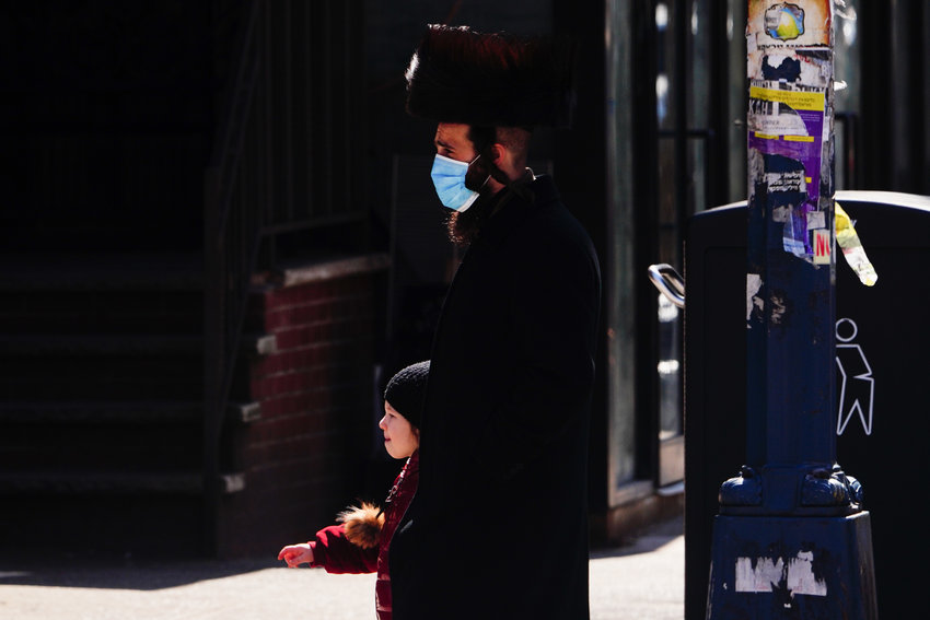 A view of orthodox jewish men wearing mask during Passover in Williamsburg in Brooklyn New York USA during coronavirus pandemic on April 11, 2020. (Photo by John Nacion/NurPhoto)