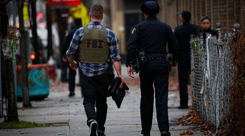 A FBI officer arrives at the scene of an active shooting in Jersey City, N.J., Dec. 10, 2019.