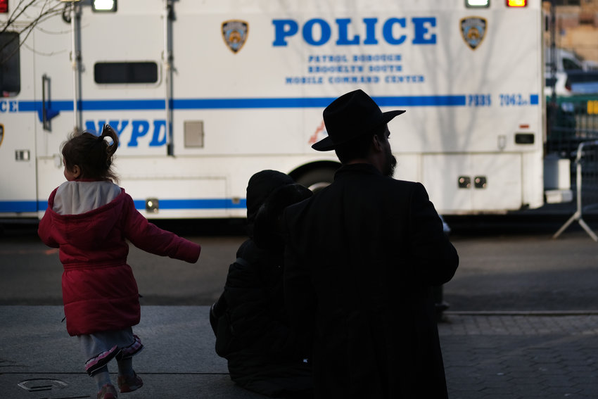 NEW YORK, NEW YORK - DECEMBER 31: People walk through the Orthodox Jewish section of the Crown Heights neighborhood in Brooklyn on December 31, 2019 in New York City. Five Orthodox Jews were stabbed at a synagogue on Saturday evening in the upstate New York town of Monsey. Tensions remain high in Jewish communities following a series of attacks and incidents in recent weeks.  (Photo by Spencer Platt/Getty Images)