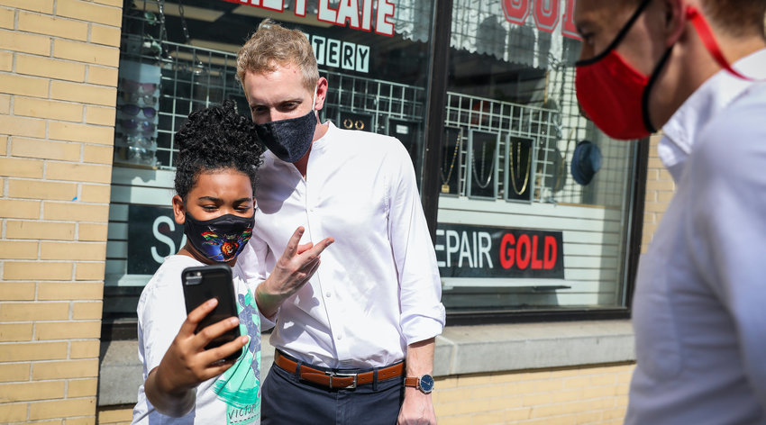HOLYOKE, MA - AUGUST 26: Mayor Alex Morse of Holyoke takes a selfie with a 10-year-old as he tours downtown Springfield, MA and introduces himself to business owners on Aug. 26, 2020. Days ahead of the Sept. 1 primaries, Morse will challenge Representative Richard Neal in the First Congressional District primary. (Photo by Erin Clark/The Boston Globe via Getty Images)