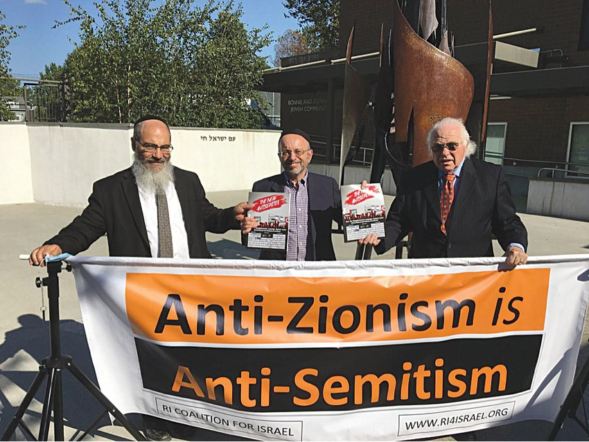 "Marc Adler (center) presents personal copies of ""The New Anti-Semites"" to Rabbi Raphie Schochet (left) and Judge Ed Newman (right)."