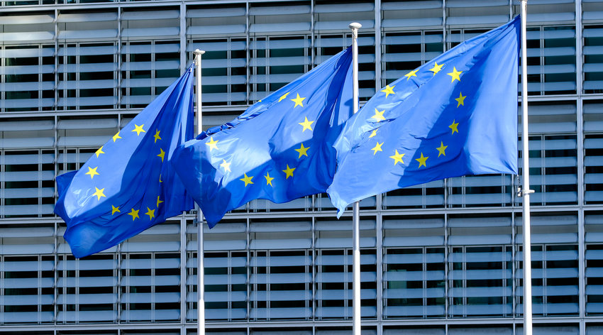 BRUSSELS, BELGIUM - SEPTEMBER 24: THree EU flags are seen in front of the Berlaymont on September 24, 2020 in Brussels, Belgium. The Berlaymont building is the headquarters of the European Commission, in Brussels, at the confluence of rue de la Loi and boulevard Charlemagne. It houses the offices of the President of the European Commission and the twenty-seven European Commissioners.