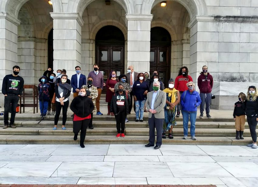 In post-COVID advocacy, September 2020, community advocates gathered outside with masks and social distancing to rally for an equitable state budget.