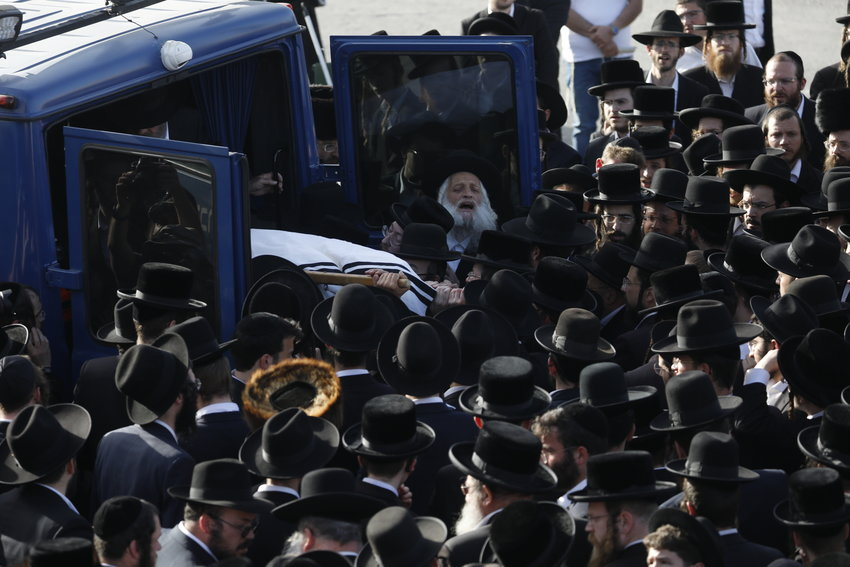 Hundreds of ultra orthodox jewish attend the funeral of Yehuda Lev Lubin in Jerusalem, one of the victims of the Meron tragedy, where 45 people were crushed to death last night, and several more injured, at amass event for the Jewish holiday of Lag B'Omer, in Meron, Northern Israel, April 30, 2021. Olivier Fitoussi/Flash90