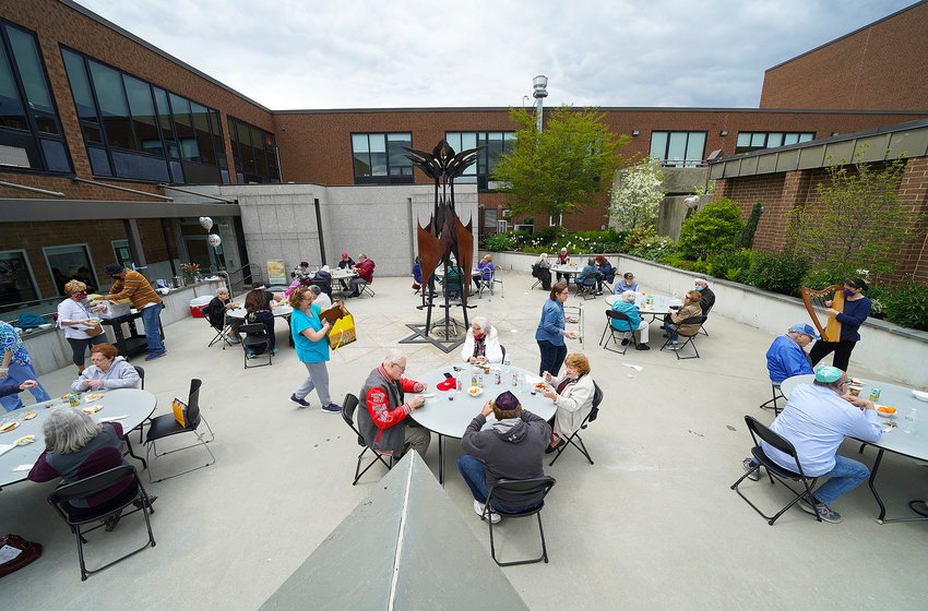 The kosher meal site has its first meeting outdoors in the back of the Dwares JCC in the Holocaust Memorial Garden.