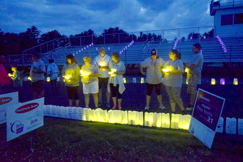 Luminaria, shown at a past Relay For Life of Greater Attleboro event, are typically lit around a track in honor of cancer survivors and in memory of cancer victims.