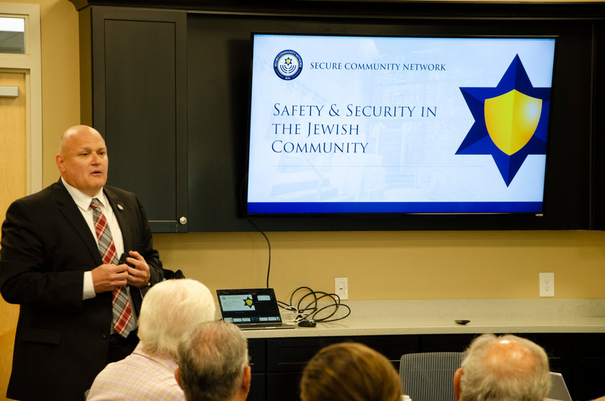 Brad Orsini speaks to a group at the Jewish Alliance of Greater Rhode Island.