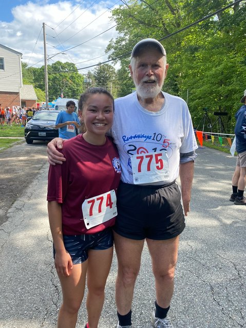 Larry Kessler and his daughter Alana share a moment after the race.