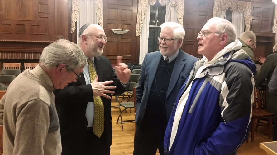 Rabbi Daniel Lehmann and Phil Cunningham, second and third from left, have a conversation with audience members after the event.