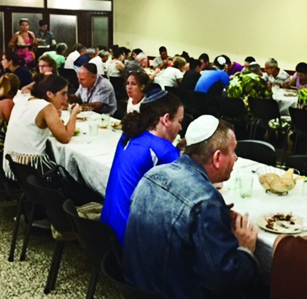 Shabbat dinner is served in the social hall.