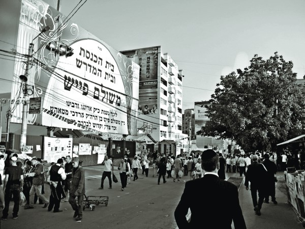 In Uman, Hebrew letters cover store fronts and the sides of buildings so that from a photograph it looks more like Bnei Brak than Eastern Europe.