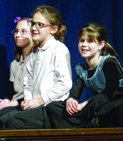 Students in grades 3-5 perform in the play at the pre-Hanukkah celebration on Dec. 21. The play taught important lessons about sharing.