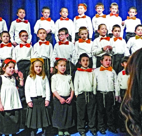 Student in grades 1-3 perform in the choir at the pre-Hanukkah celebration on Dec. 21. 