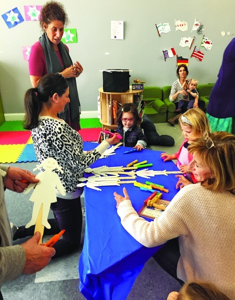 Children under age 5 gathered Feb. 24 at the Dwares JCC in Providence to learn about Purim with a story and fun activities including a craft. A snack was also provided.