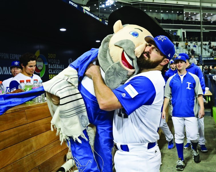 Cody Decker of Team Israel holding team mascot the Mensch on a Bench after the World Baseball Classic game against the Netherlands in Seoul, South Korea, March 9.