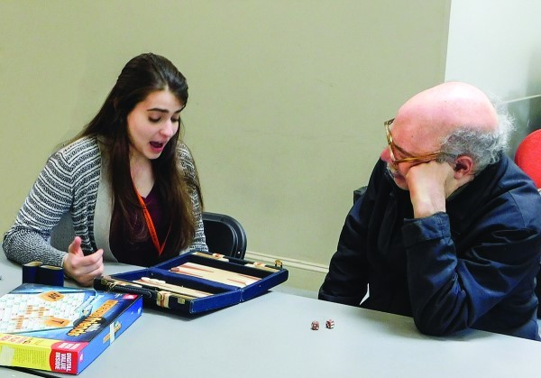 Dwares Jewish Community Center teens recently enjoyed an afternoon of board games and conversation with Kosher Café seniors, following a meal.