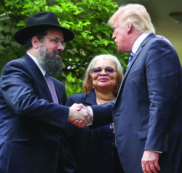 President Donald Trump greeting clergy members, including Rabbi Marvin Hier, right, in the Rose Garden 