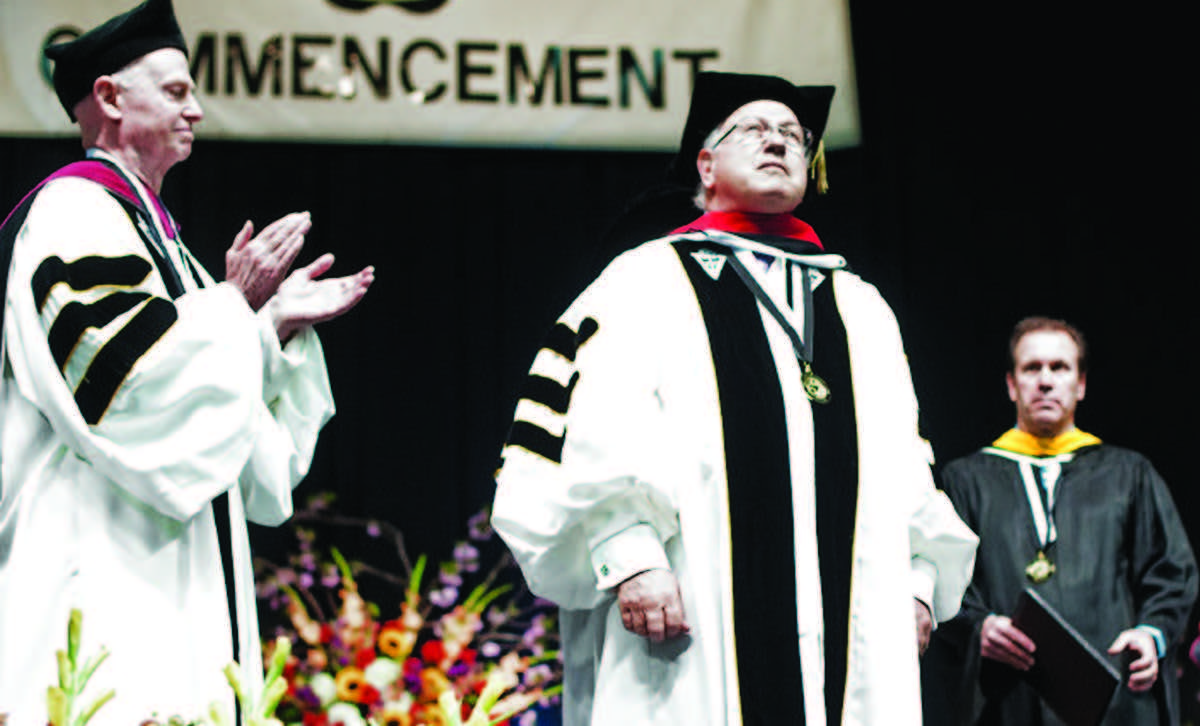 Onstage at graduation, (left to right) Fr. Kenneth R. Letoile, O.P., Provincial of the Dominican Province of St. Joseph and chair of the Providence College Corp., Rabbi Wayne Franklin and Charles Haberle, assistant vice president 