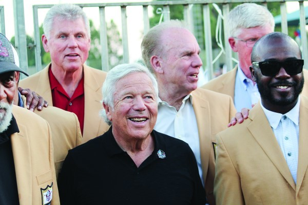 Robert Kraft, in black shirt, with Hall of Famers Marshall Faulk, right, and, in rear, from left, Ron Yary, Roger Staubach and Dave Casper in Ramat Hasharon, Israel, June 15.