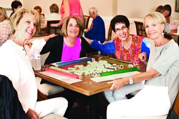 Playing cards are (left to right)  Margi White, cardroom co-chair; Loretta Bready; Joan Reuter; and  Gail Galkin.