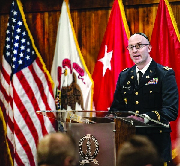 Capt. Aaron Rozovsky of the Rhode Island Army National Guard, gives the invocation at Brigadier Gen. Alicia Tate-Nadeau's retirement ceremony.