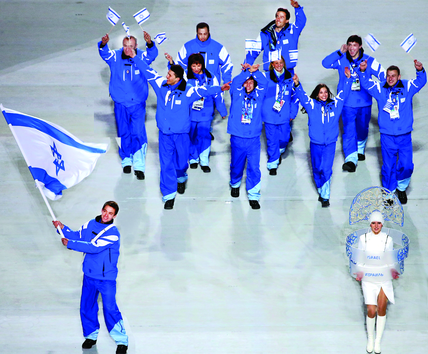 Short track speed skater Vladislav Bykanov, lower left, leading the Israeli Olympic team at the opening ceremony of the Winter Olympics in Sochi, Russia, Feb. 7, 2014.