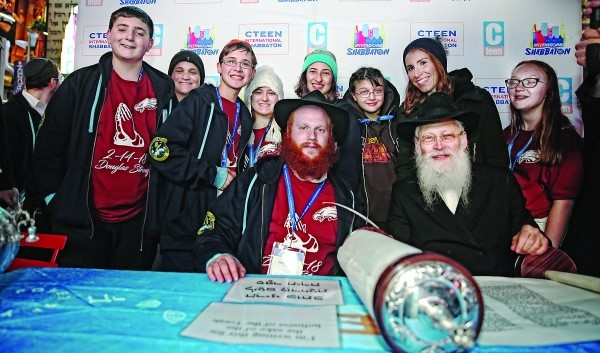 In center, with the red beard, Rabbi Shaya Denburg, co-director of CTeen in Coral Springs, Florida, with Rabbi Moshe Klein on his left; Chayale Denburg, co-director of CTeen in Coral Springs, standing second from right; and some survivors of the Parkland, Florida, school shooting. The survivors were in New York this weekend for Chabad's CTeen conference.