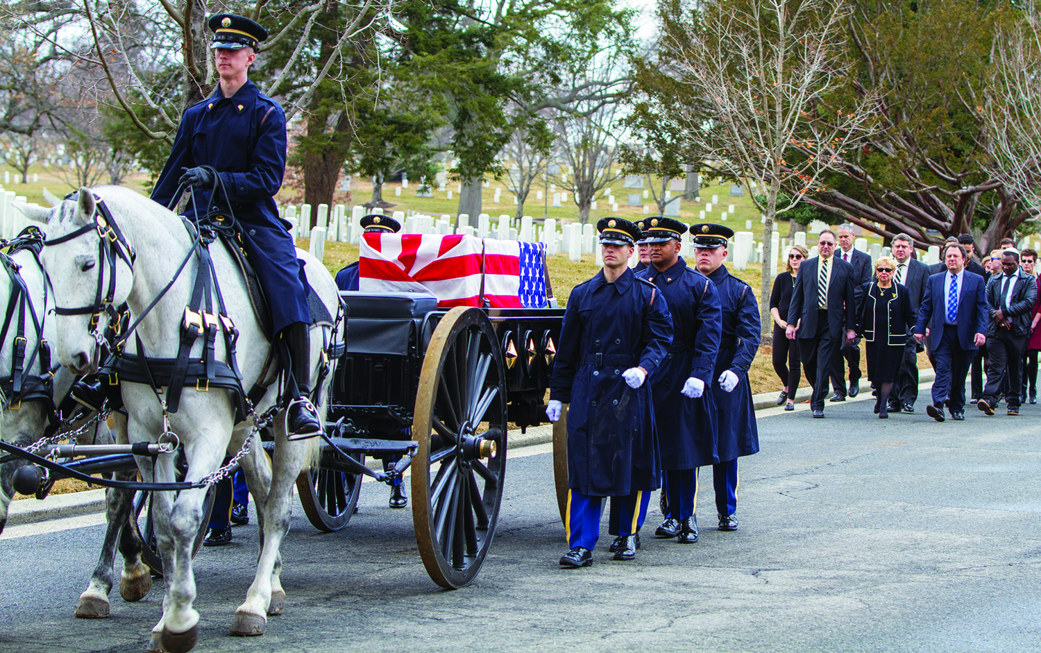 The caisson with the casket of Lt. Col. Jack Lustig heads to the burial site at 
