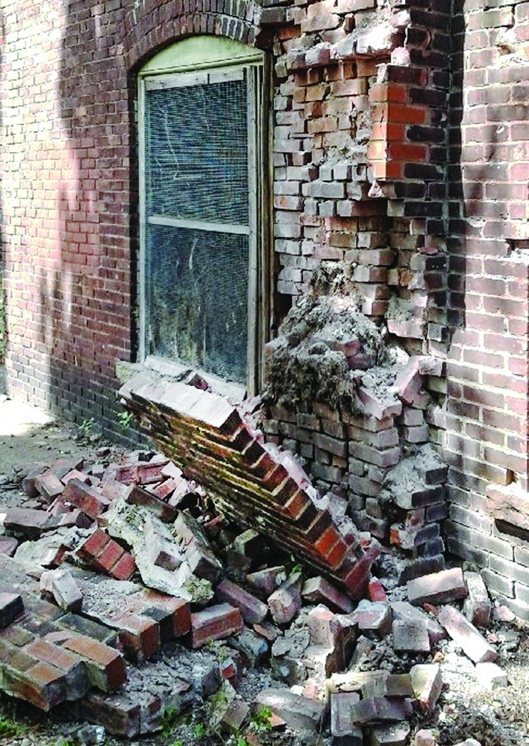 Before: The section of toppled brick on the side rear 