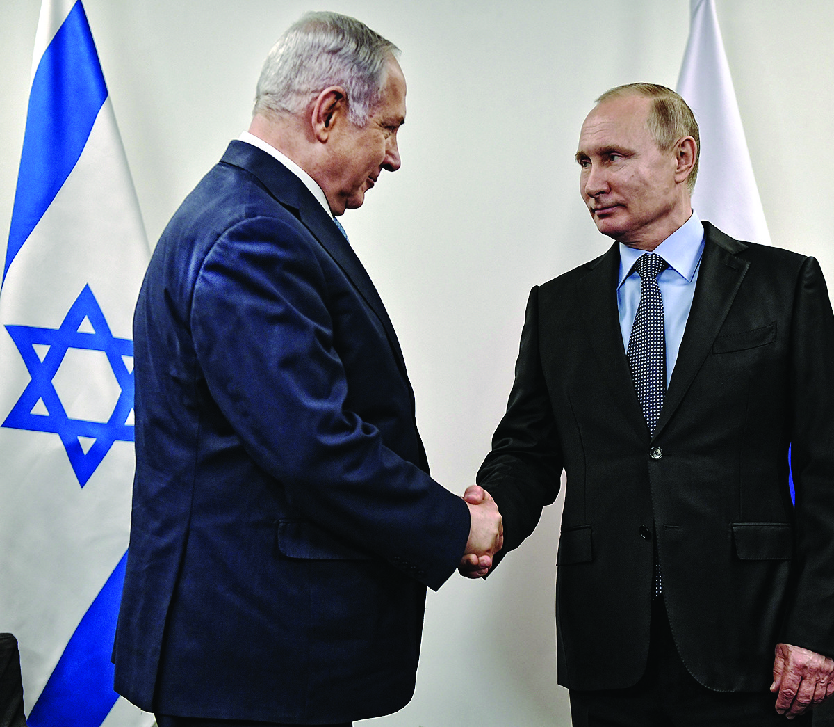 Russian President Vladimir Putin, right, greets Israeli Prime Minister Benjamin Netanyahu at the Jewish Museum and Tolerance Center in Moscow, Jan. 29, 2018.