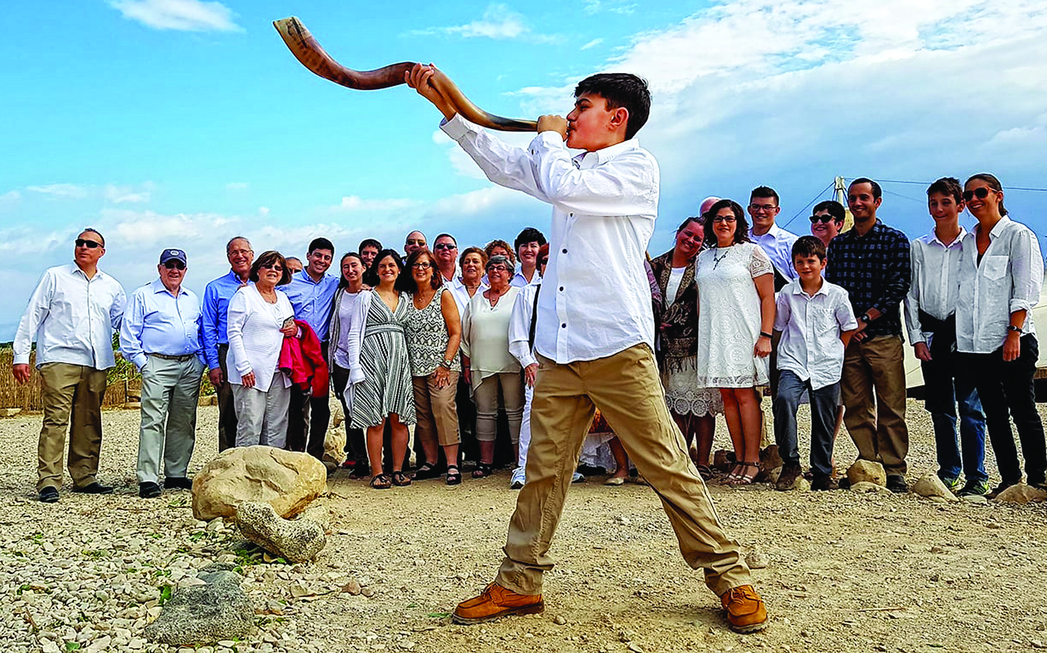 Cooper Sock blows the shofar in front of family and friends in Israel.