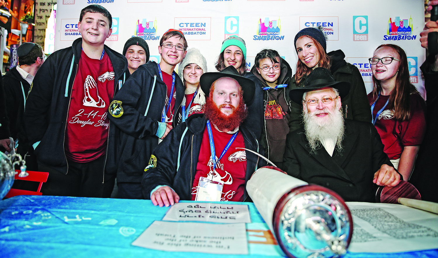 Rabbi Shaya Denburg, center with red beard, Rabbi Moshe Klein, and some of the survivors of Parkland, Florida school shooting.