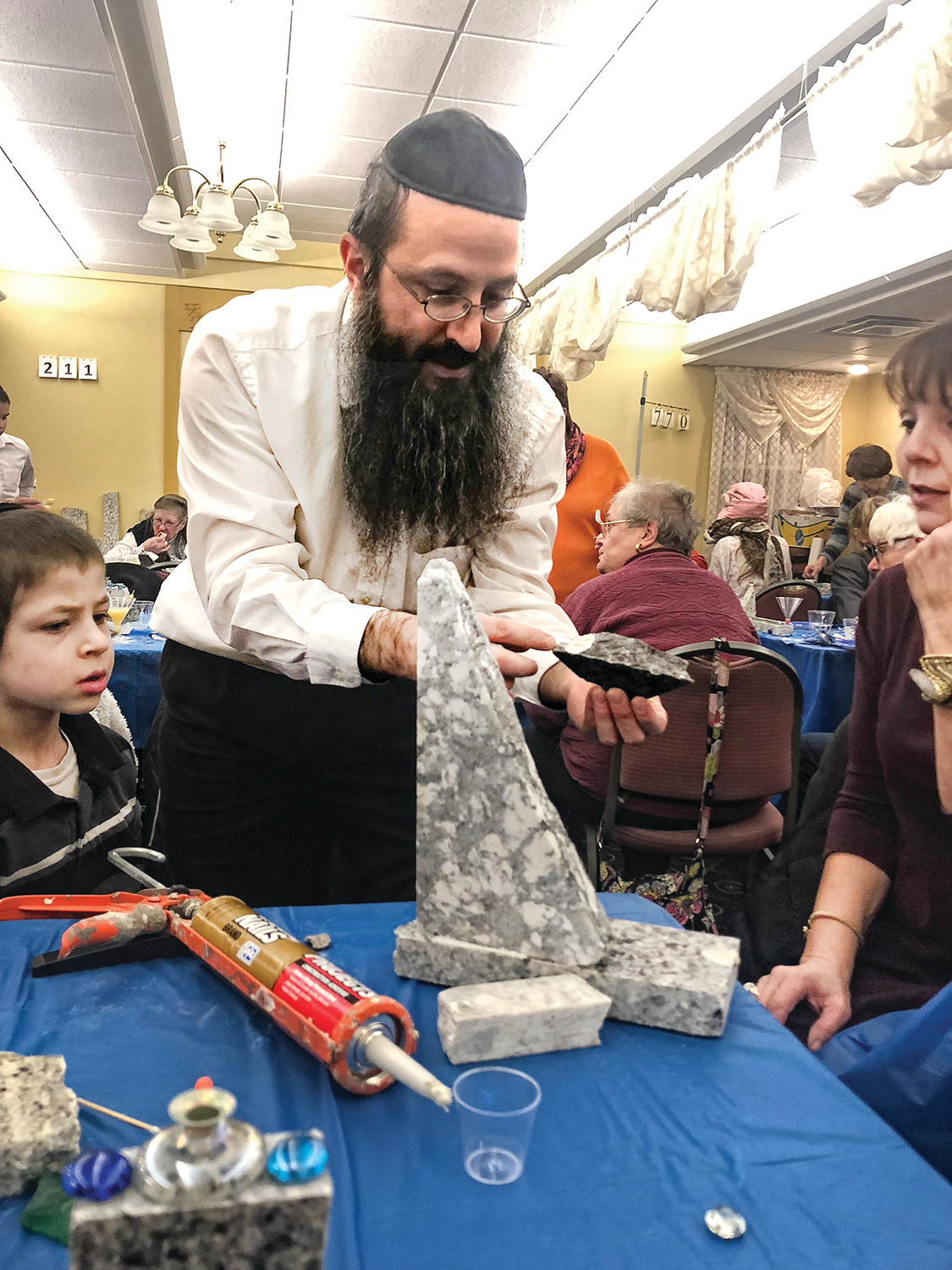 At a recent Menorahs and Martinis event hosted by West Bay Chabad, Beverly Paris reports that 40 to 50 ladies attended and all went home with a handmade menorah. Shoshana Laufer hosted and Rabbi Yossi Laufer helped. Paris reports there was good food and good company as well as beautiful menorahs.