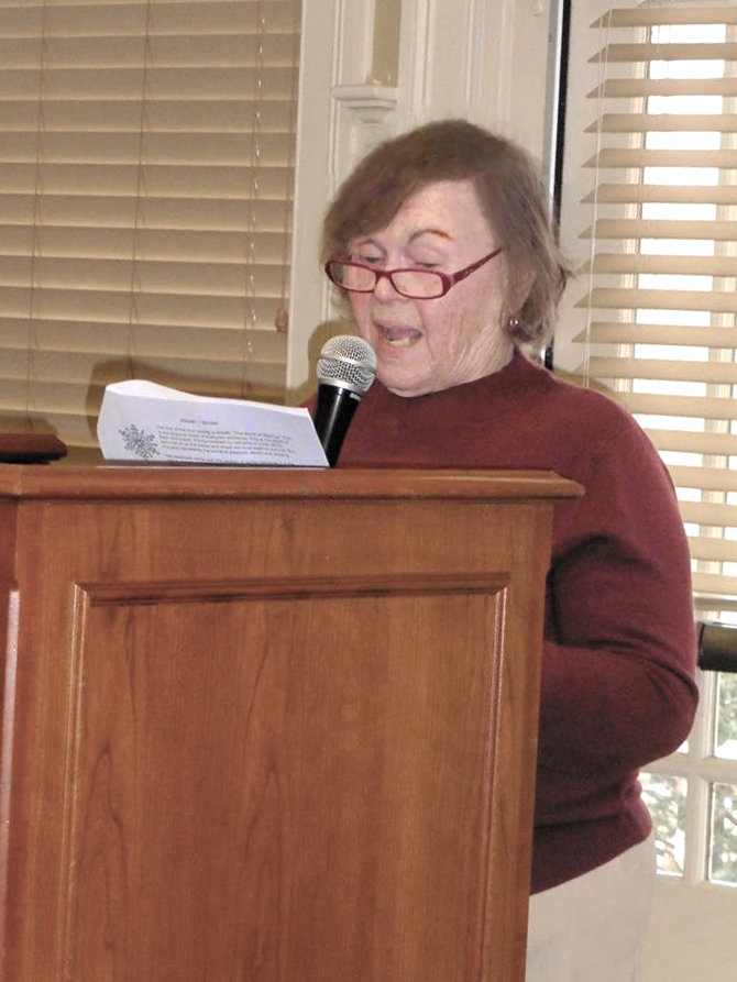 Phyllis Solod, of Warwick, leads the Tu b'Shevat seder.