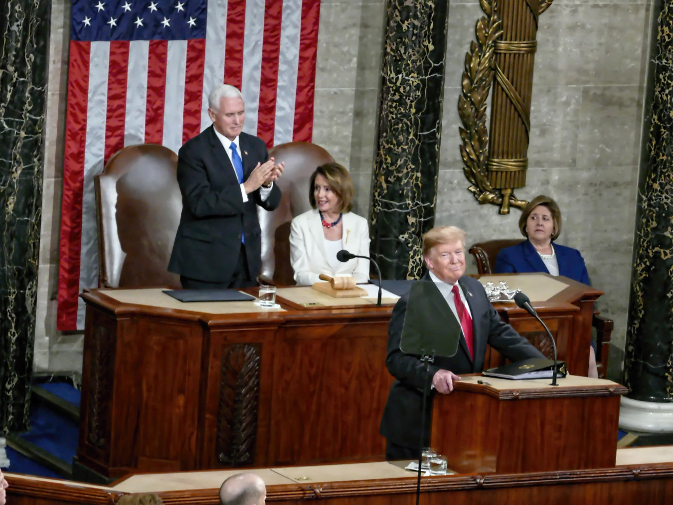 During the State of the Union address in February, Nancy Pelosi, Speaker of the House, sits out an applause line as Vice President Pence rises in support of many of the President's agenda priorities including building a wall to prevent illegal immigration, limiting late term abortions, and defending America against Socialism.