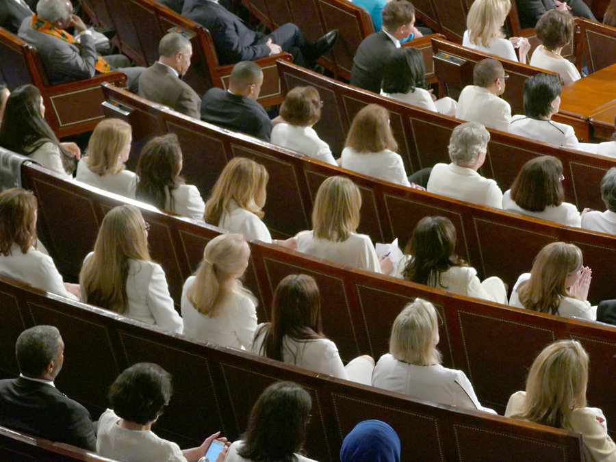 A large contingency of women, many newly elected to the House of Representatives, wore white in support of the suffrage movement.