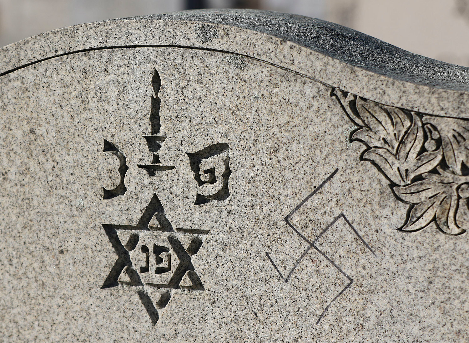 One of the vandalized grave stones.