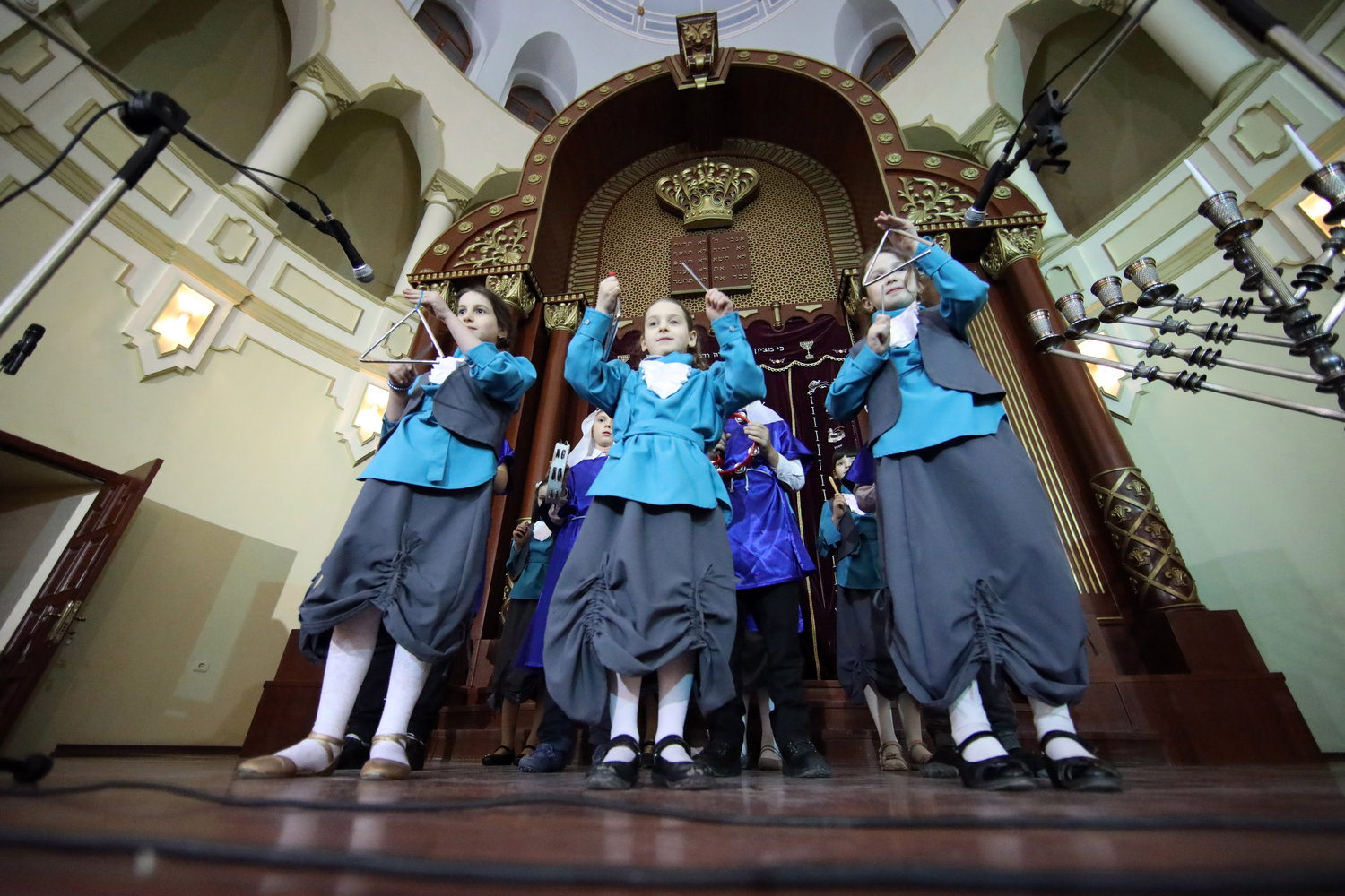 Children play musical instruments during the celebration of Hanukkah at the Kharkiv Choral Synagogue, Kharkiv, northeastern Ukraine, December 5, 2018. Also known as the Festival of Lights, the holiday is observed for eight nights and days. This year, the festivities take place on December 2-10. Ukrinform. (Photo credit Vyacheslav Madiyevskyy / Barcroft Media via Getty Images)