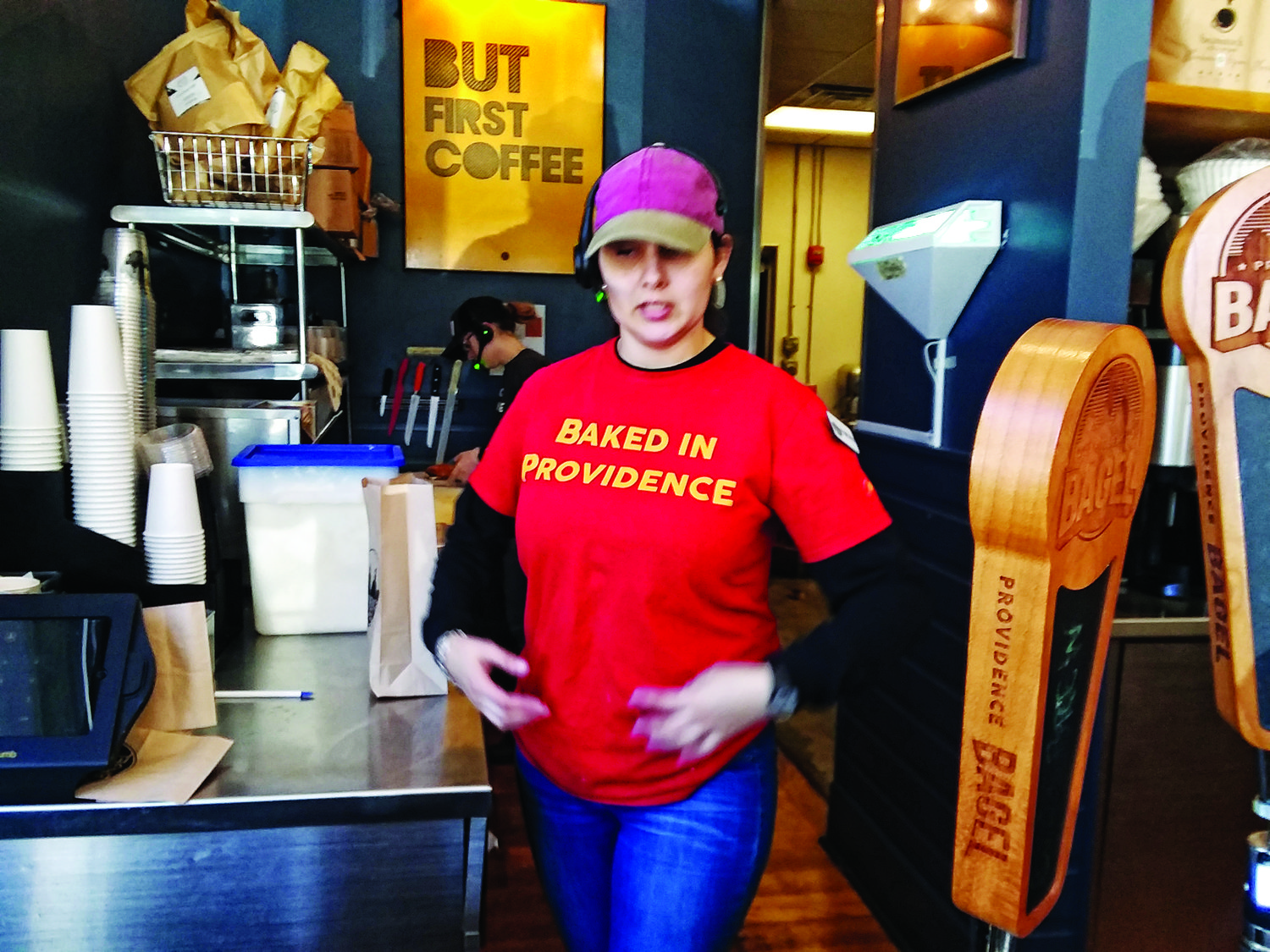 Francesca Guerra models one of the T-shirts at Providence Bagel.