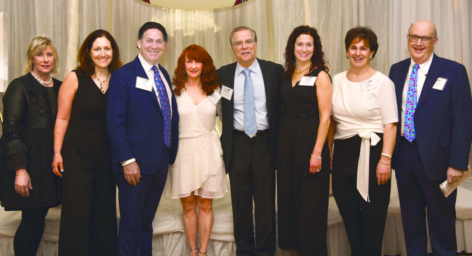 At the gala (left to right): Susan Bazar,  Mindy Stone, Jeffrey M. Padwa,  Marisa Garber,  Richard A. Licht, Amanda Isenberg, Erin Minior,  and Rabbi Les Gutterman.