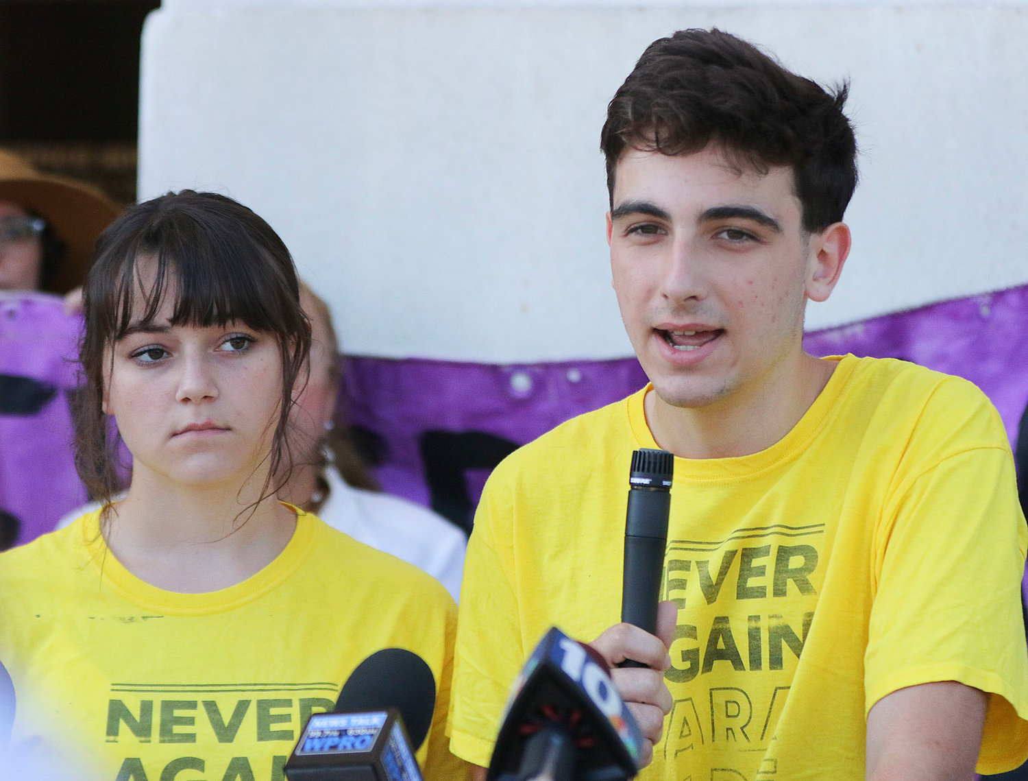 Siblings, Ruby, 15,  left, and Sam, 17, Goldstein,  of Providence,  speak to the crowd at the news conference Aug. 20.