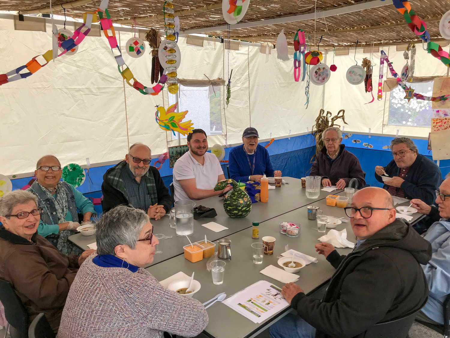 Guests of the Kosher Senior Cafe at the Dwares Jewish Community Center ate lunch in the sukkah.