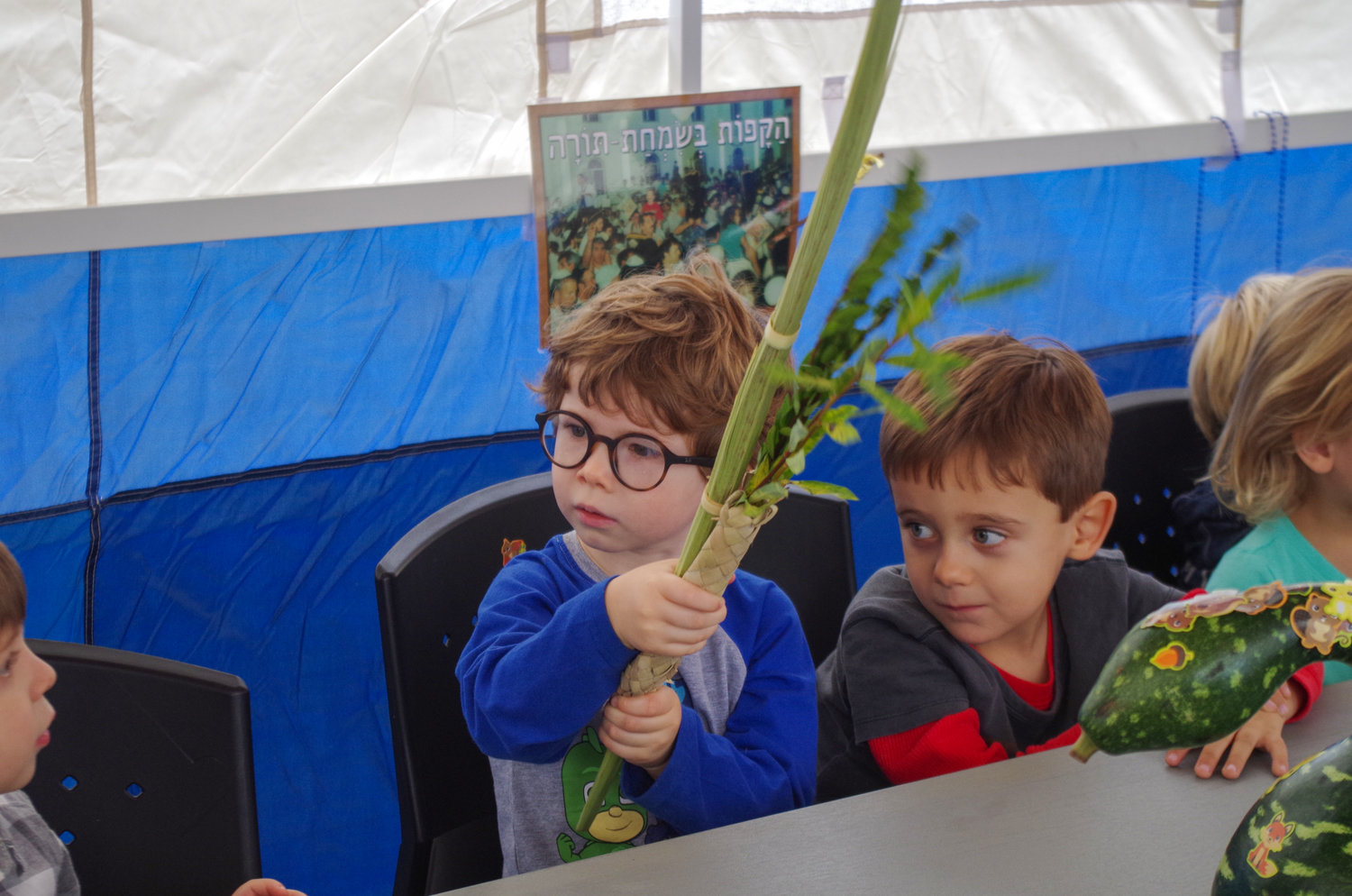 Children from the David C. Isenberg Early Childhood Center at the Dwares Jewish Community Center in Providence had an opportunity to shake the lulav during their visit to the sukkah.