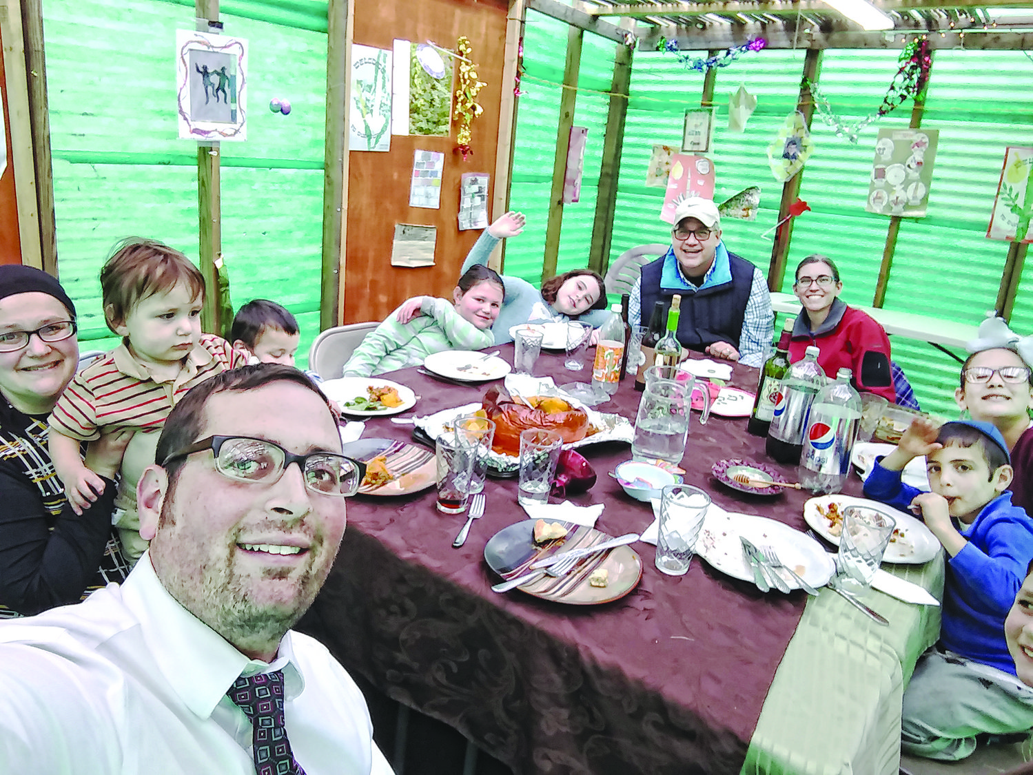 The Karp family sukkah was filled with family and visitors.