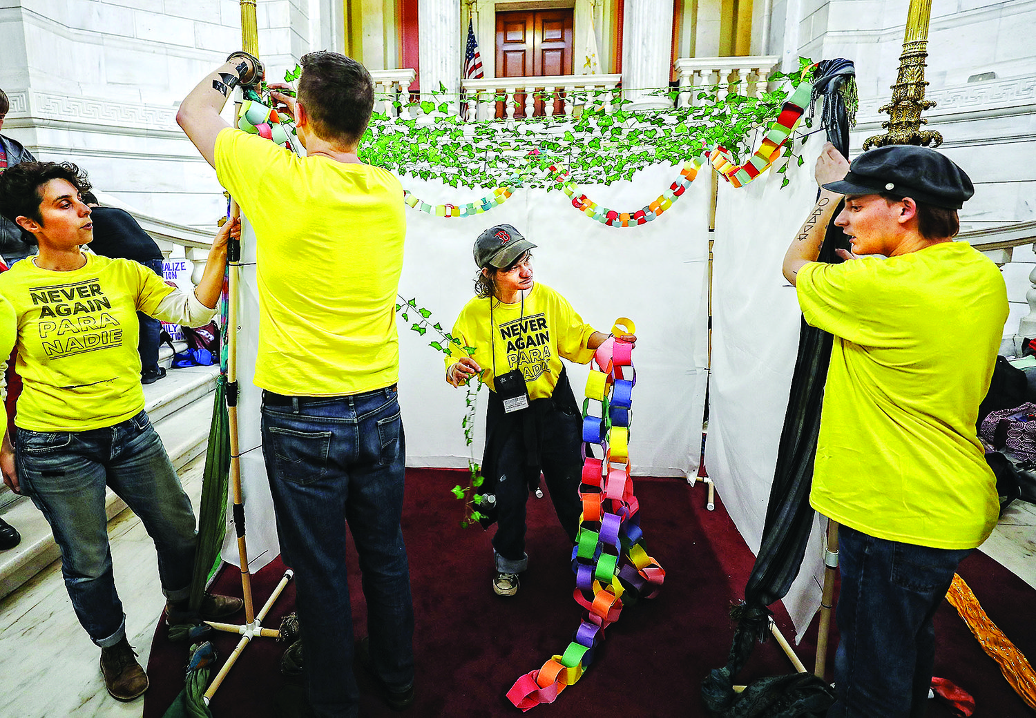 A rally at the RI State House sponsored by Never Again Action included building a sukkah.