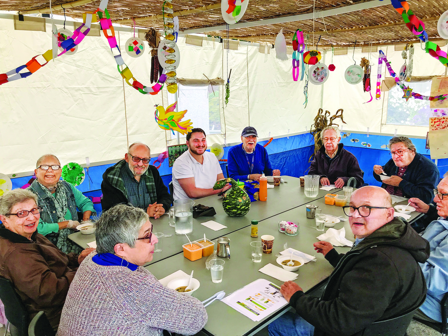 Guests at the Kosher Senior Café at the Dwares JCC ate lunch in the sukkah.