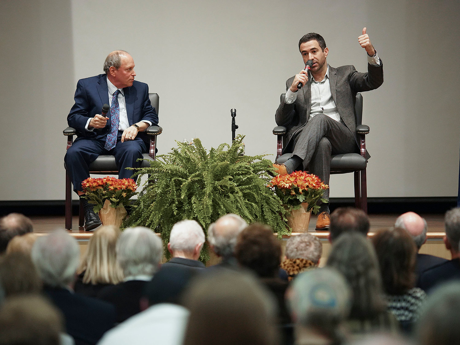 Ari Melber, of MSNBC and NBC, answers a question from Alan Rosenberg executive editor of the Providence Journal at the Jewish Alliance of Greater Rhode Island's Campaign Event Nov 3.