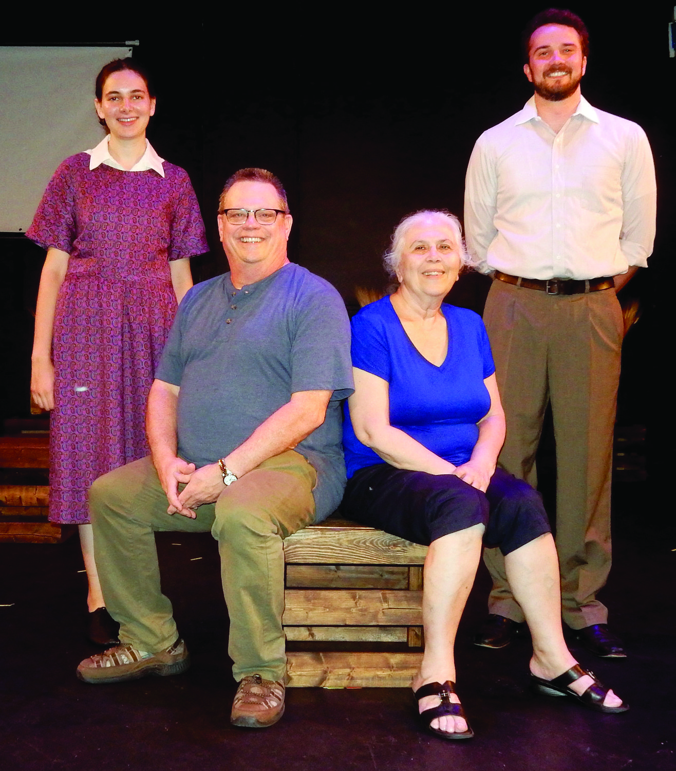 "Hannah Antman and Alex Ireys are standing in a picture taken during the Chicago performances of ""How Many Bushes Am I Worth?"" Kevin Olson is seated with Bena Shklyanoy. Jake Malavsky  will play the role of Alex in the Providence production."