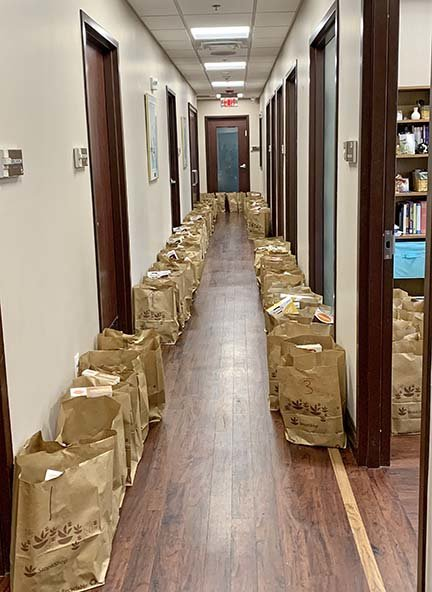 Packaed bags line the hallway at Jewish Collaborative Services.