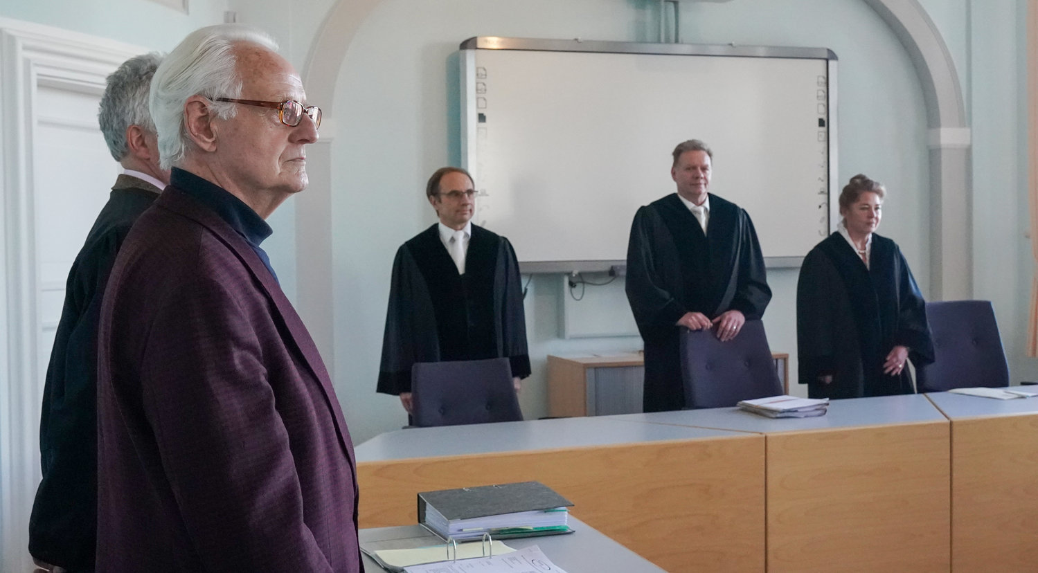Plaintiff Michael Dietrich Duellmann, left, stands in the courtroom of the Higher Regional Court in Naumburg, in a hearing about the removal of the Judensau on the Wittenberg city church, Jan. 21, 2020.